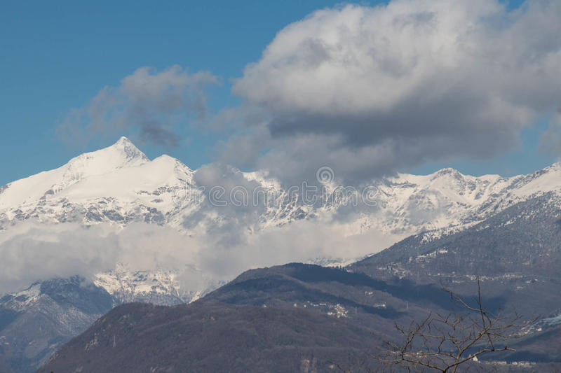 Snowy mountain massif in Val di Susa. Piedmont. Italy stock photography