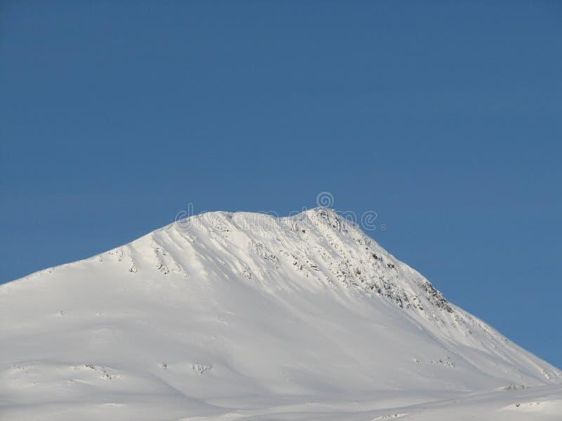 Snowy mountain peak stock photo