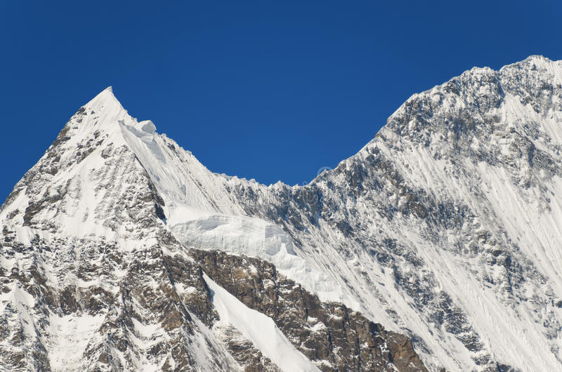 Snowy mountain peak - beauty of nature royalty free stock images