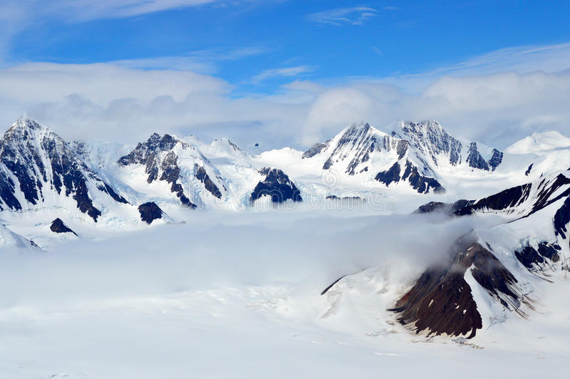Snowy Mountain Peaks in the Clouds, Kluane National Park, Yukon 02 royalty free stock image