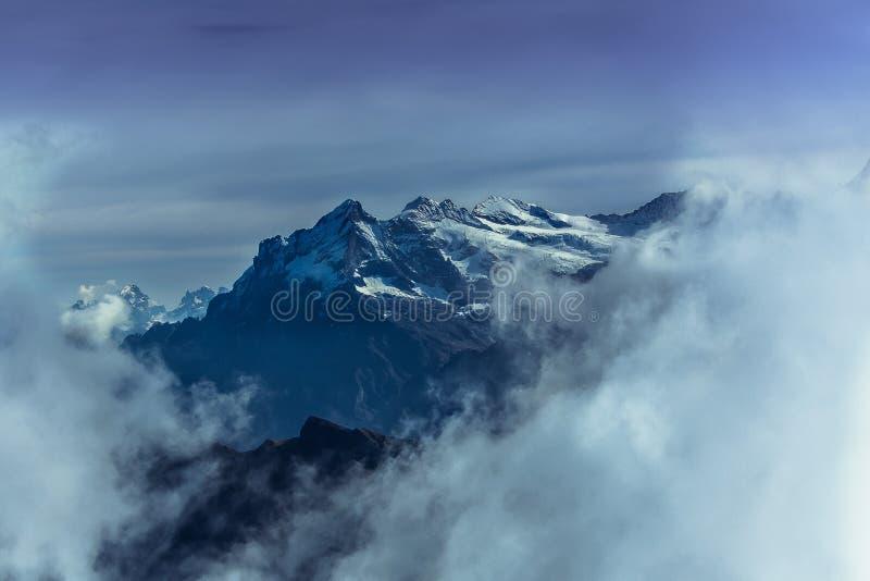Snowy mountain peaks in switzerland stock photography