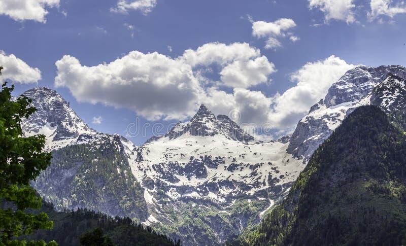 Snowy mountain range in Austria: Loferer Steinberge. Mountain Range in Austria in Summer: Snow mountain peak, Loferer Steinberger, mountains, snowy, summertime stock photos