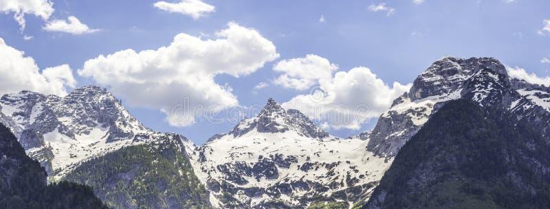 Snowy mountain range in Austria: Loferer Steinberge. Mountain Range in Austria in Summer: Snow mountain peak, Loferer Steinberger, mountains, snowy, summertime stock image