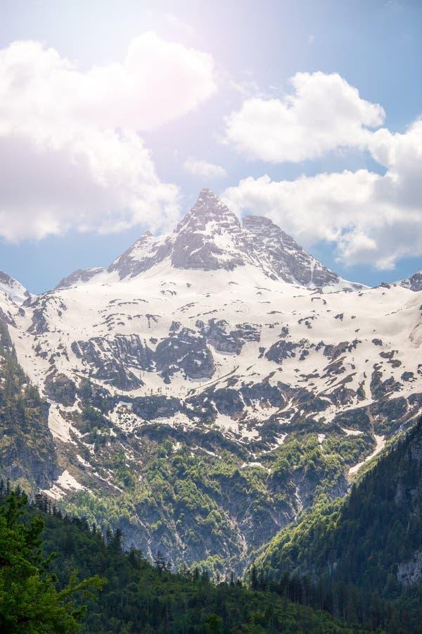 Snowy mountain range in Austria: Loferer Steinberge. Mountain Range in Austria in Summer: Snow mountain peak, Loferer Steinberger, mountains, snowy, summertime royalty free stock photography