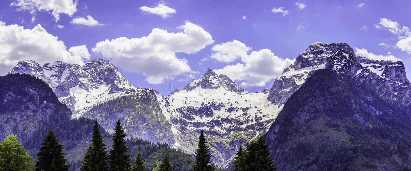 Snowy mountain range in Austria: Loferer Steinberge. Mountain Range in Austria in Summer: Snow mountain peak, Loferer Steinberger, mountains, snowy, summertime royalty free stock photo