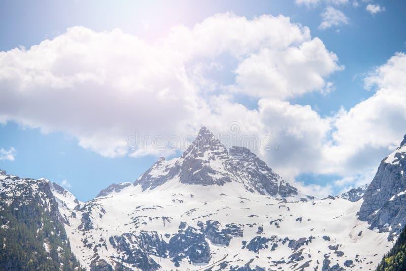 Snowy mountain range in Austria: Loferer Steinberge. Mountain Range in Austria in Summer: Snow mountain peak, Loferer Steinberger, mountains, snowy, summertime stock images