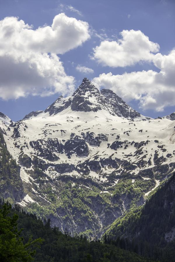 Snowy mountain range in Austria: Loferer Steinberge. Mountain Range in Austria in Summer: Snow mountain peak, Loferer Steinberger, mountains, snowy, summertime royalty free stock images