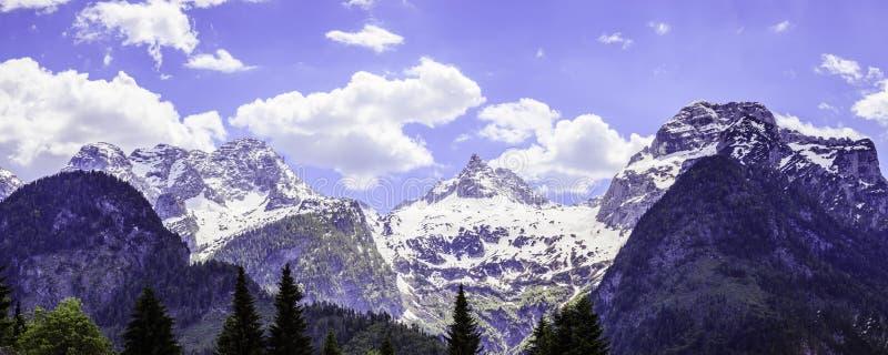 Snowy mountain range in Austria: Loferer Steinberge. Mountain Range in Austria in Summer: Snow mountain peak, Loferer Steinberger, mountains, snowy, summertime stock photo
