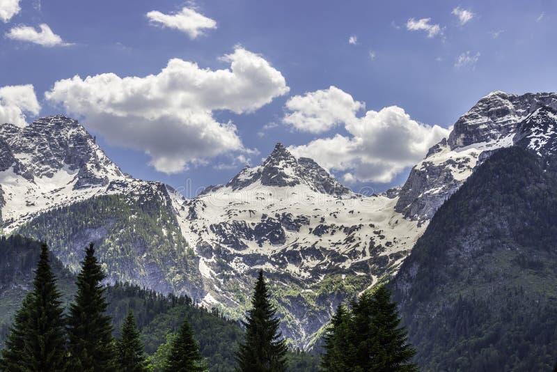 Snowy mountain range in Austria: Loferer Steinberge. Mountain Range in Austria in Summer: Snow mountain peak, Loferer Steinberger, mountains, snowy, summertime stock photography