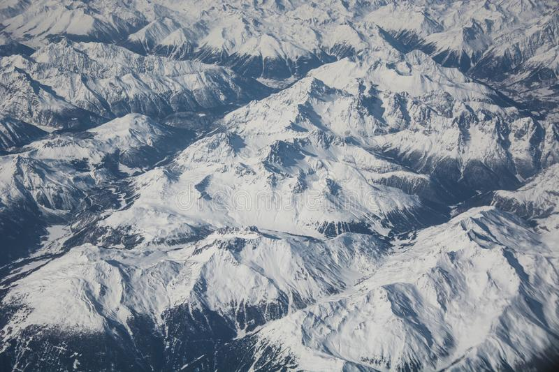 Snowy mountain range stock photos