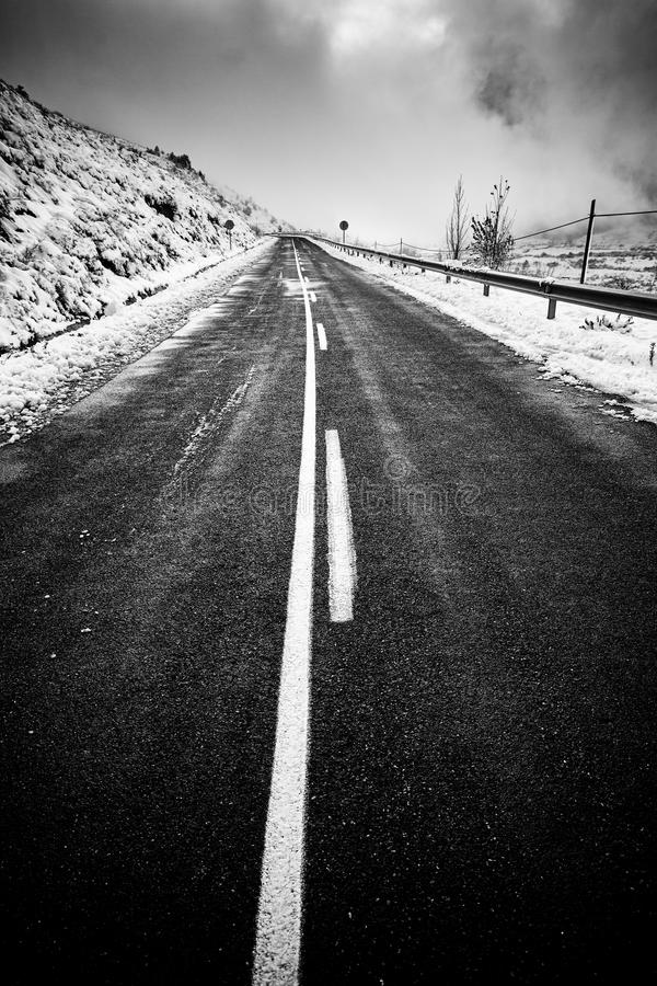 Snowy mountain road in winter royalty free stock photo