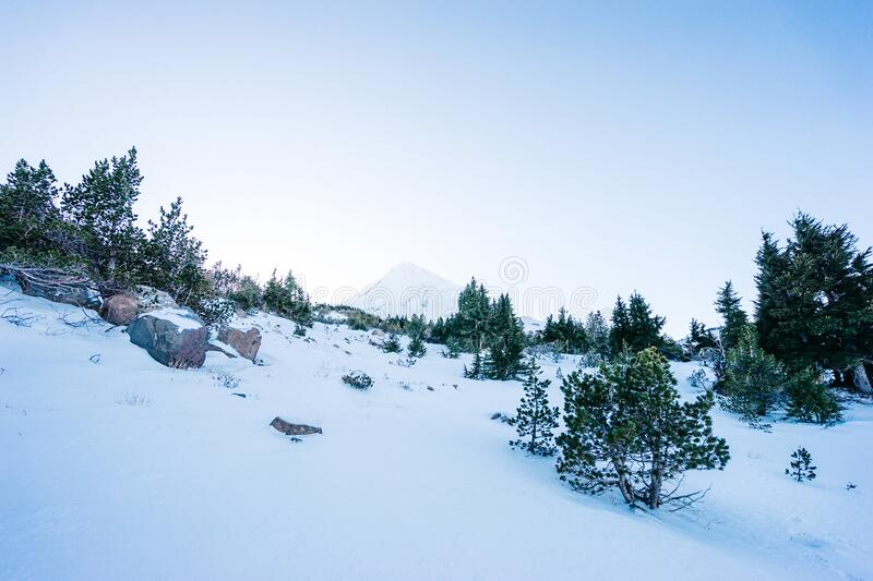 Snowy mountain slopes stock images