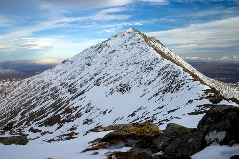 Snowy mountain summit royalty free stock photography