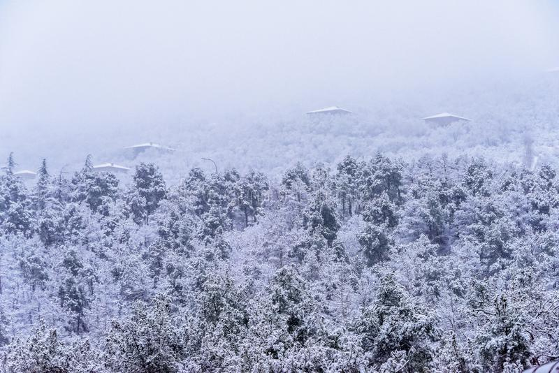 Snowy mountain top with villas royalty free stock image