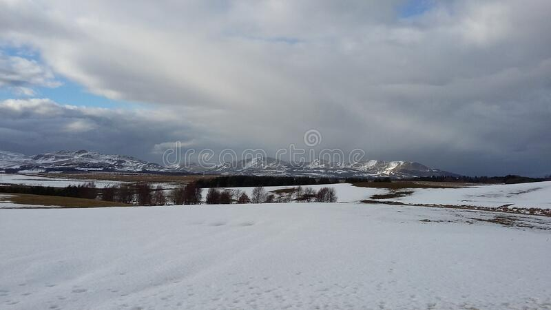 A snowy, mountainous landscape in Scotland during winter royalty free stock photo