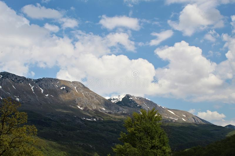 Snowy mountains against dramatic sky. stock images