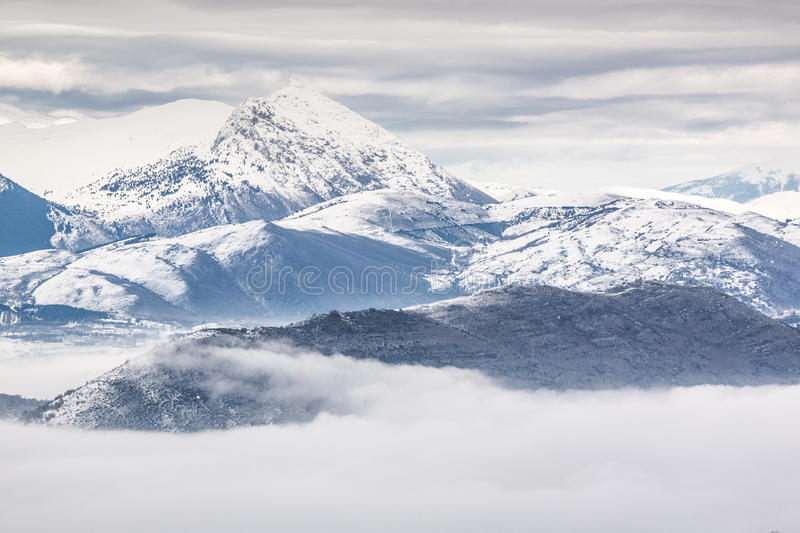 Snowy mountains with fog royalty free stock photos