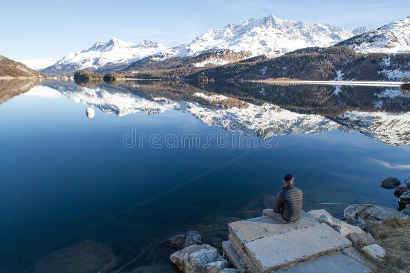 Snowy mountains and lake reflection royalty free stock image