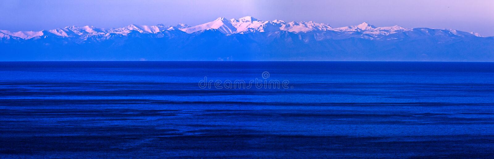 Download Snowy Mountains Over Blue Wintery Sea Stock Image - Image: 7696463