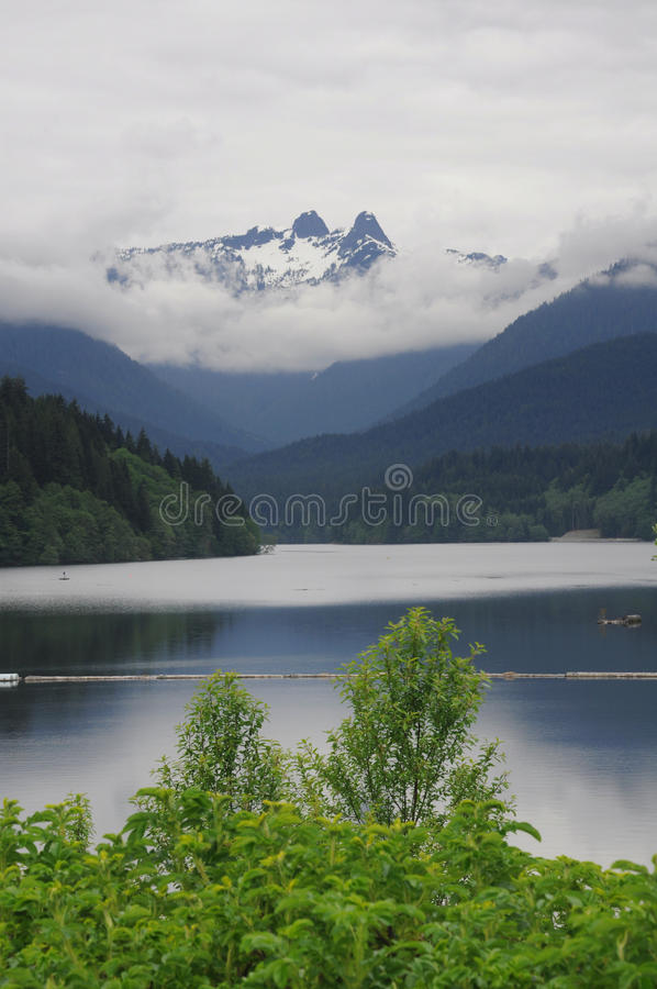 Snowy mountains over a lake stock photo