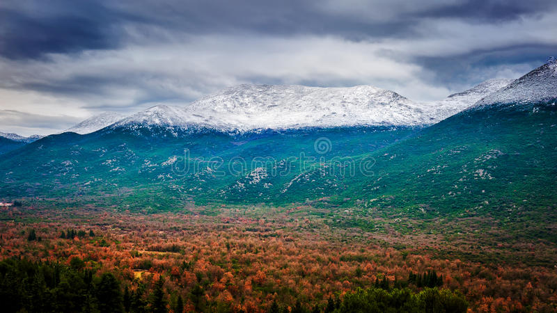 Snowy mountains peak in clouds royalty free stock image