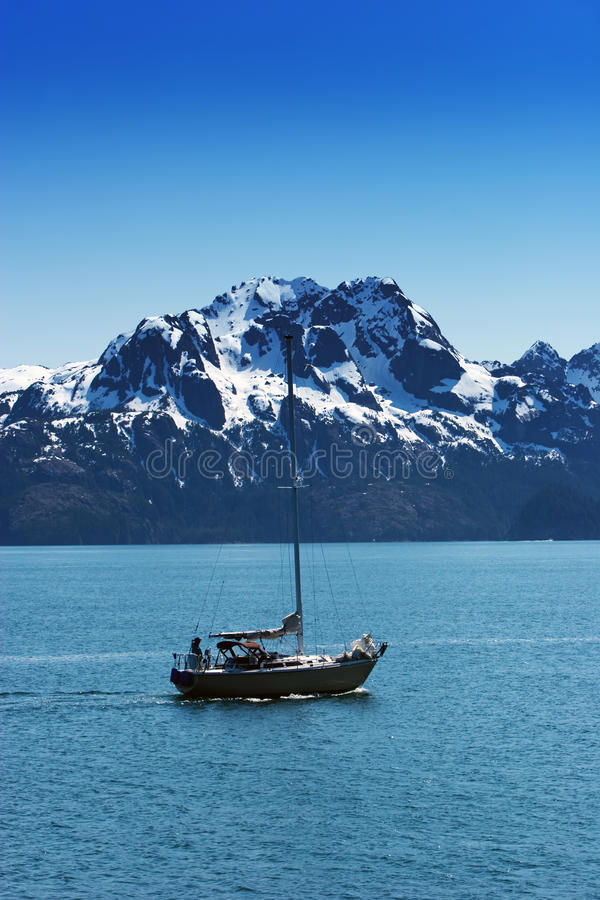 Snowy mountains by water. Snowy Alaska mountains by the water stock photography