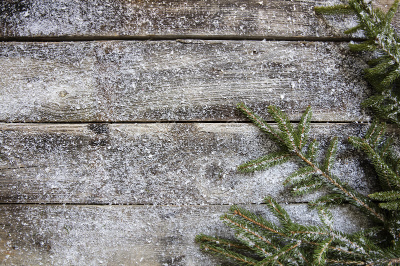 Download Snowy Old Rustic Wooden Timbers And Fir Twigs Flat Lay Stock Photo