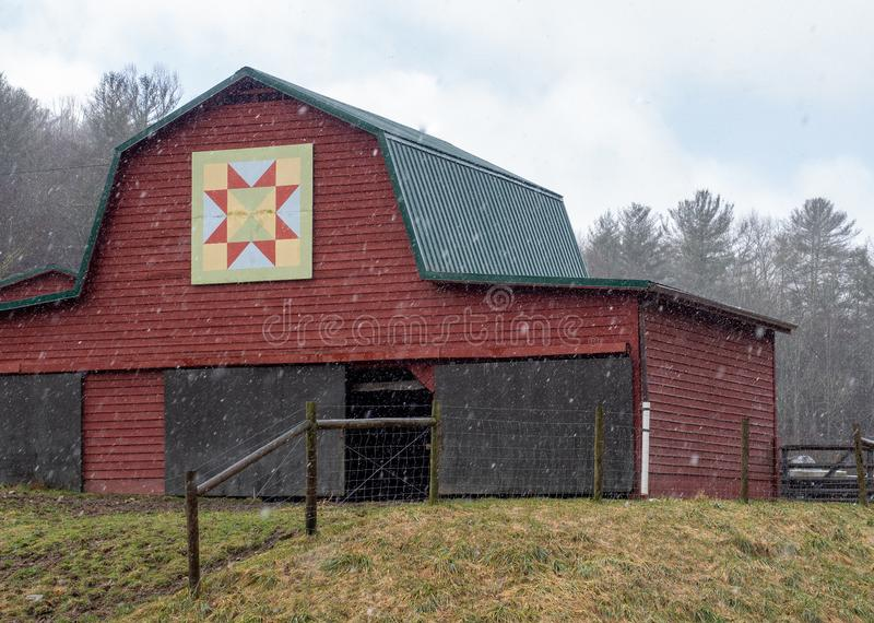 Snowy Pasture in North Carolina. Snow begins to fall on this red barn in the mountains of North Carolina stock images