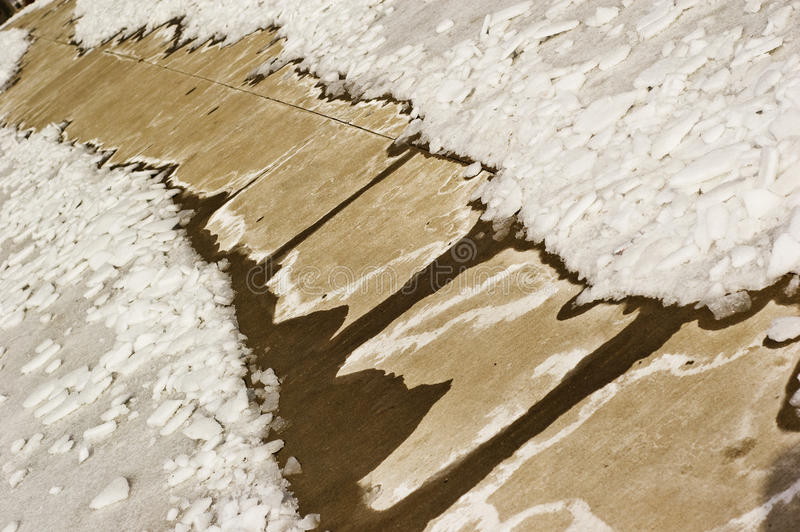 Snowy path. Concrete sidewalk path leading through the winter snow stock images