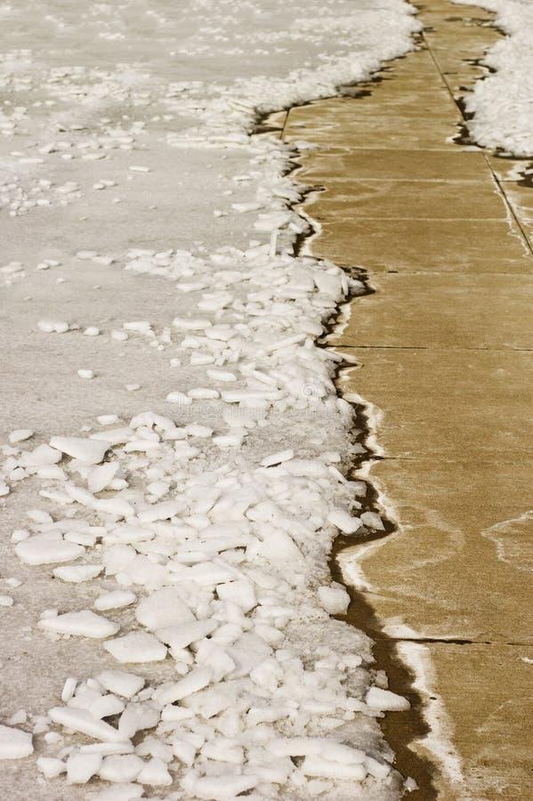 Snowy path. Concrete sidewalk path leading through the winter snow royalty free stock photo