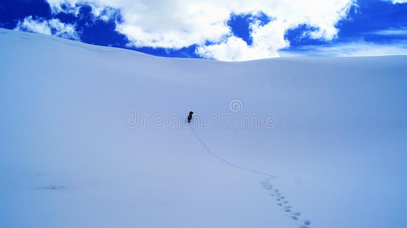 The snowy peaks of the mountains royalty free stock photography