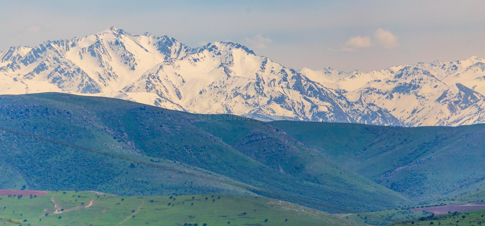 Snowy peaks of mountains in spring in Kazakhstan stock image