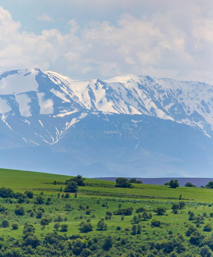 Snowy peaks of mountains in spring in Kazakhstan stock photography