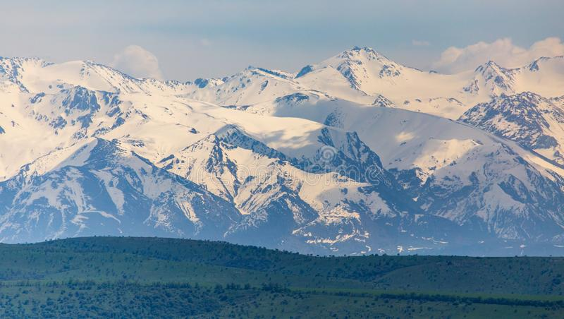Snowy peaks of mountains in spring in Kazakhstan royalty free stock photo