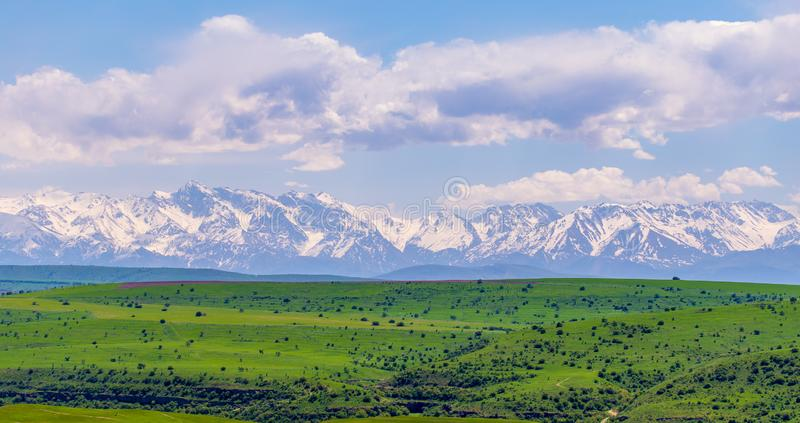 Snowy peaks of mountains in spring in Kazakhstan royalty free stock photos