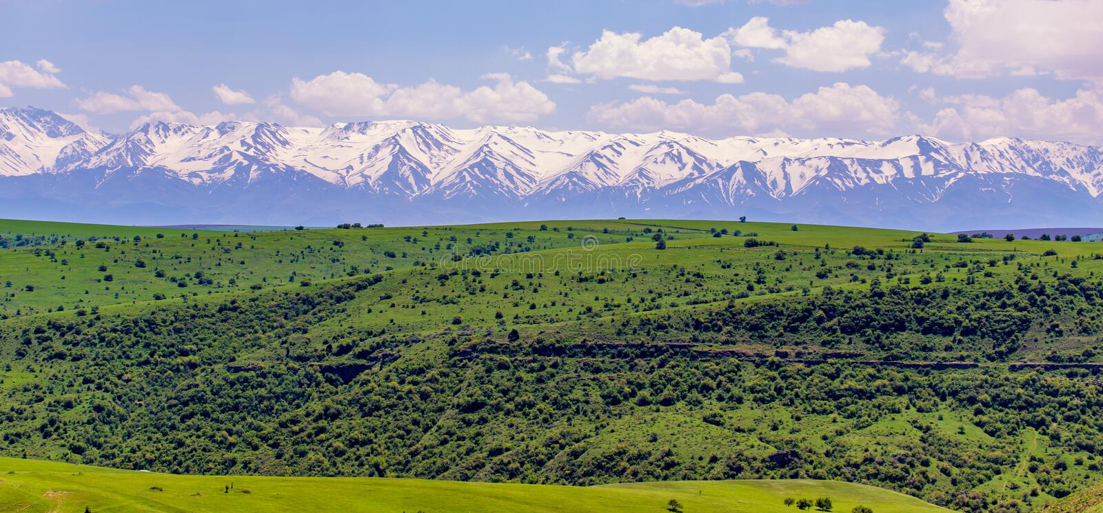 Snowy peaks of mountains in spring in Kazakhstan royalty free stock images