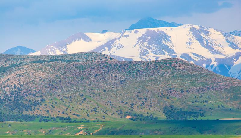 Snowy peaks of mountains in spring in Kazakhstan royalty free stock photography