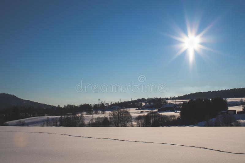 Snowy plains with tracks and farms stock images