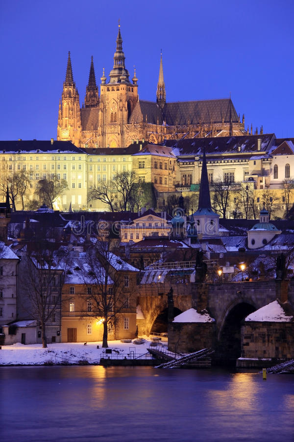 Snowy Prague gothic Castle in the Night stock photos
