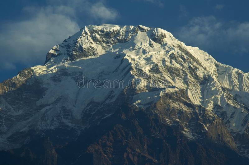 Snowy precipices of southern Annapurna. Trekking to Annapurna Ba royalty free stock image