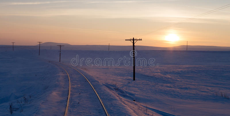 Snowy railway, sunset stock image