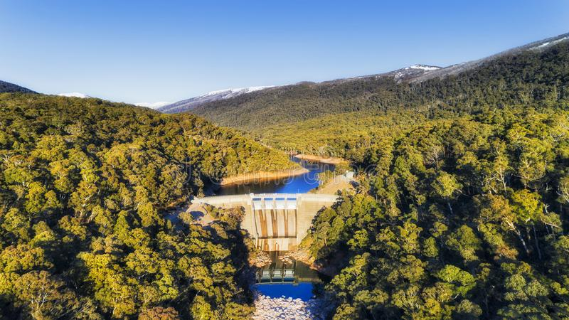 D SM Snowy river Dam. Snowy river in Snowy mountains of national park in Australia blocked by a concrete dam to generate electricity. Remote evergreen forests royalty free stock images