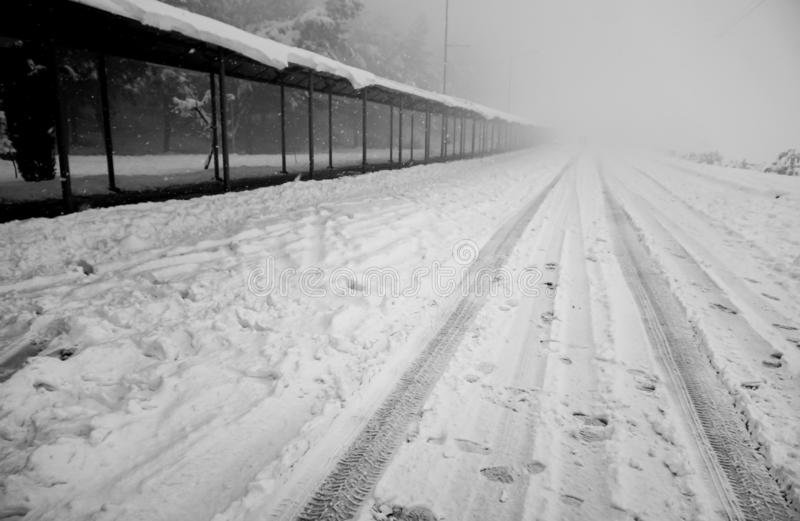 Snowy road and bus station. Foggy blank road. Izmir, Turkey stock photography