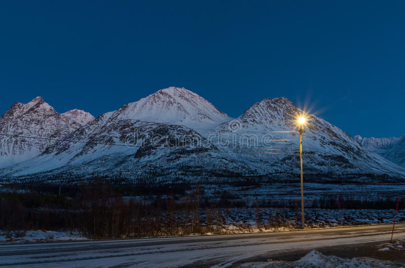 Snowy road near Svensby village in Norway during Polar Night.  stock image