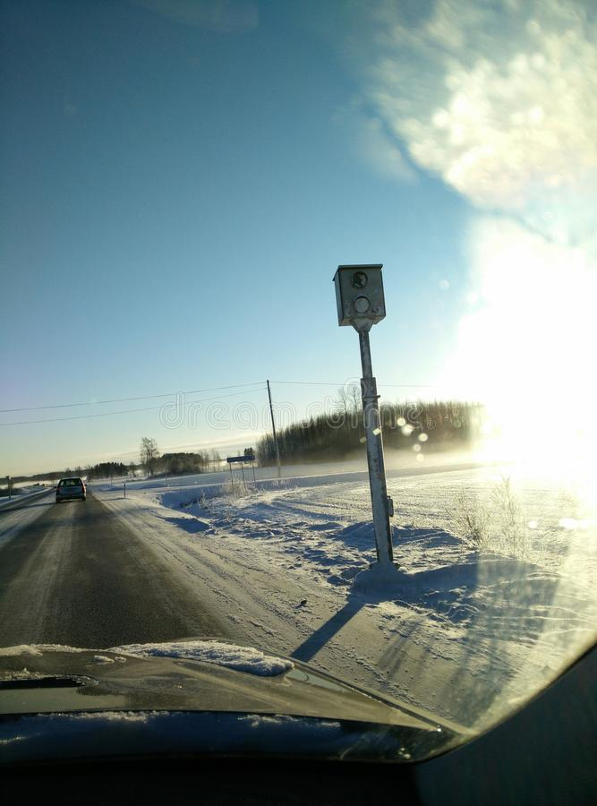 Snowy road with speed camera stock photos