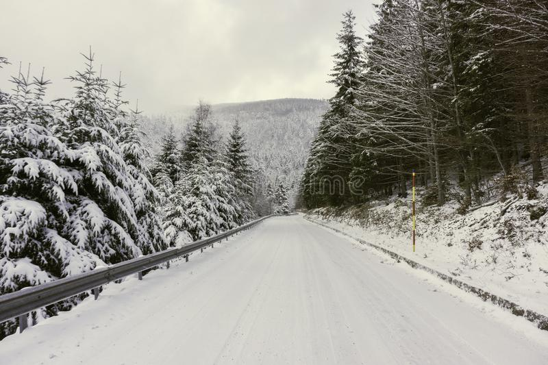 A snowy road in the mountains stock photo
