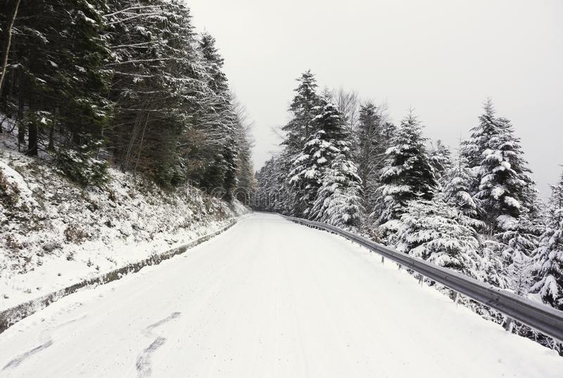 A snowy road in the mountains royalty free stock photos