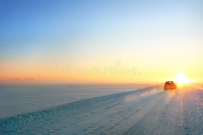 Snowy road. Winter snowy road and car at sunset stock photos