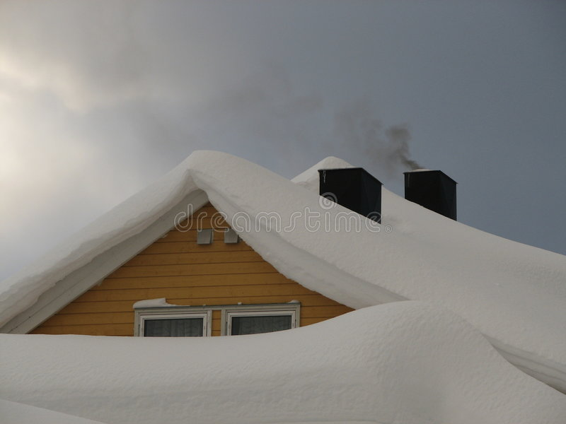 Snowy roof royalty free stock images