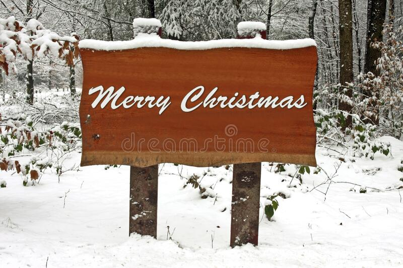 Snowy sign with Merry Christmas royalty free stock image